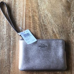 Gold authentic coach wristlet